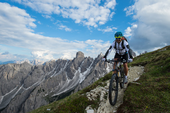 Cyclist on a mountain trail